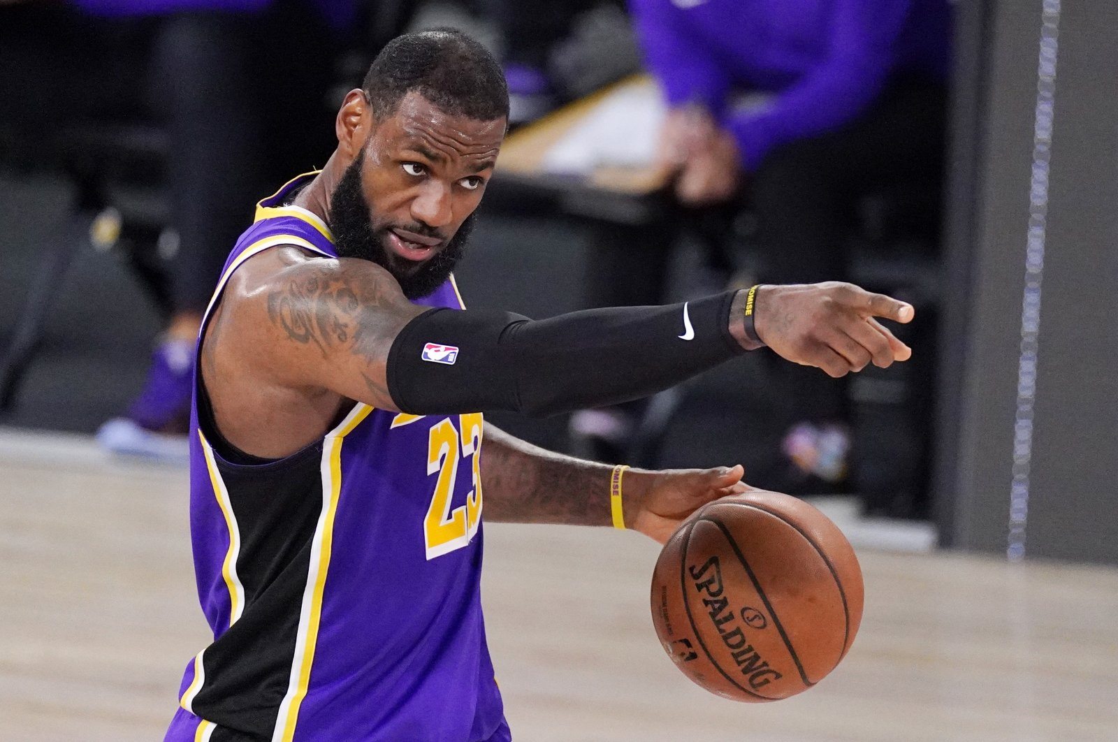 Los Angeles Lakers' LeBron James sets up a play during an NBA conference final playoff game against the Denver Nuggets, in Lake Buena Vista, Florida, U.S., Sept. 26, 2020. (AP Photo)