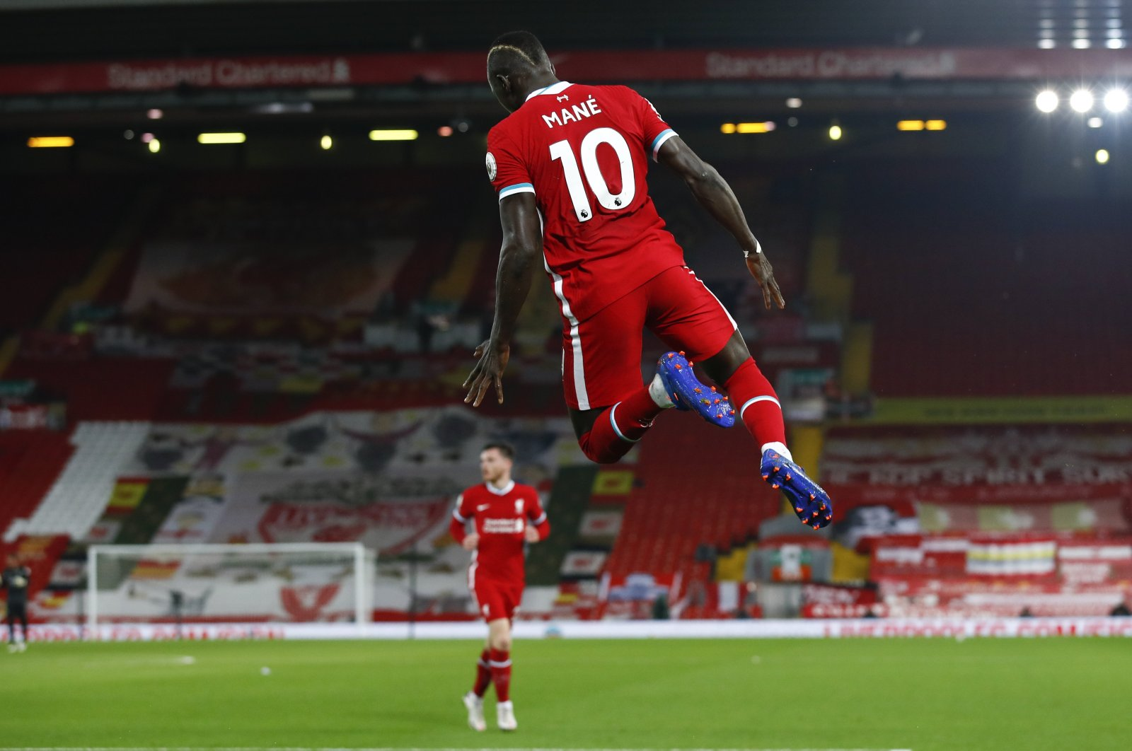 Liverpool's Sadio Mane celebrates after scoring his team's first goal during the Premier League match against Arsenal, in Liverpool, England, Sept. 28, 2020. (AP Photo)