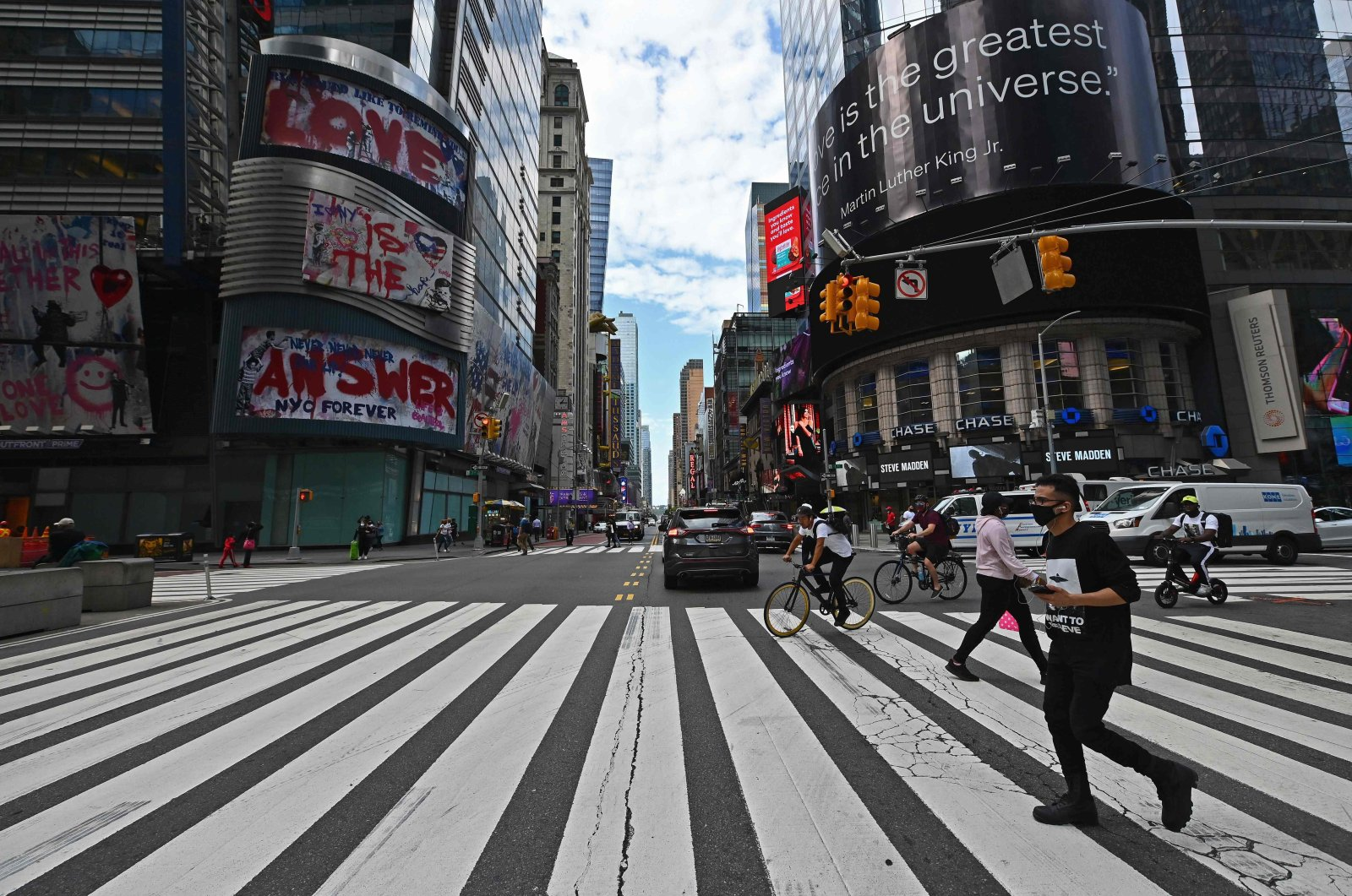 People cross the street near Time Square, New York City, Sept. 28, 2020. (AFP Photo)
