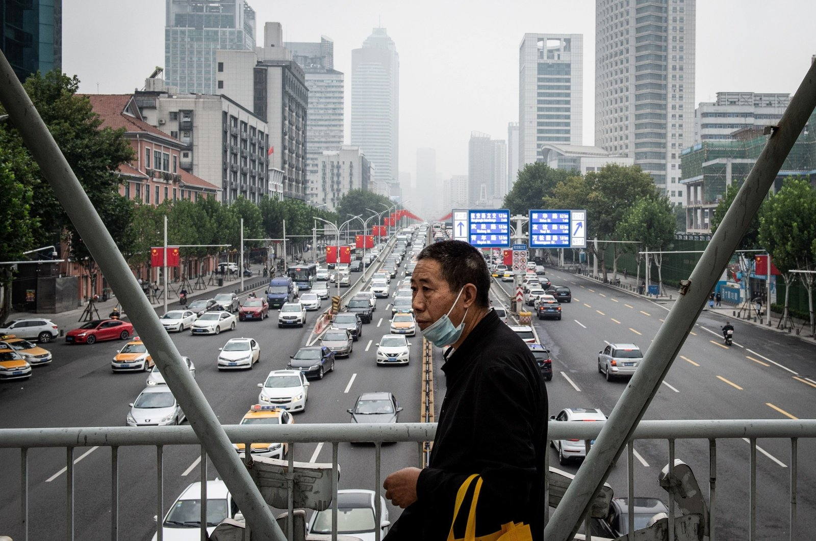 A man walks along a street in Wuhan in China's central Hubei province, Sept. 29, 2020. (AFP Photo)