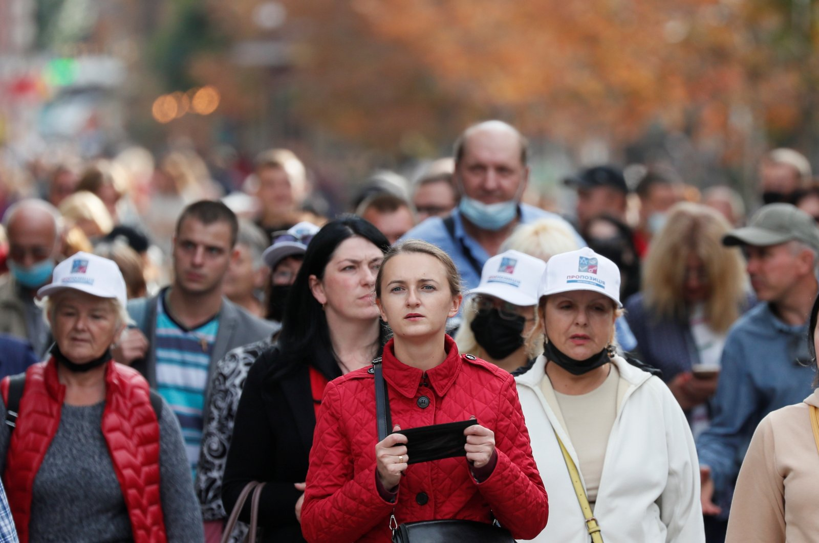 People, including a woman holding a protective face mask amid the outbreak of COVID-19, walk in central Kyiv, Ukraine, Sept. 28, 2020. (REUTERS Photo)