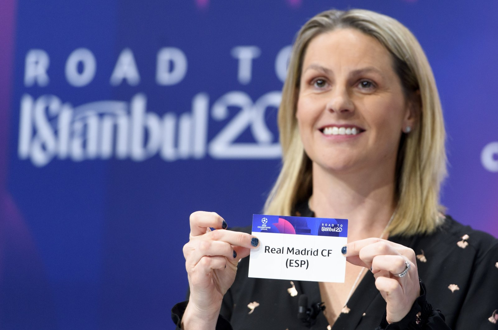 British football player Kelly Smith shows the ticket of Real Madrid during a UEFA Champions League draw in Nyon, Switzerland, Dec. 16, 2019. (AP Photo)