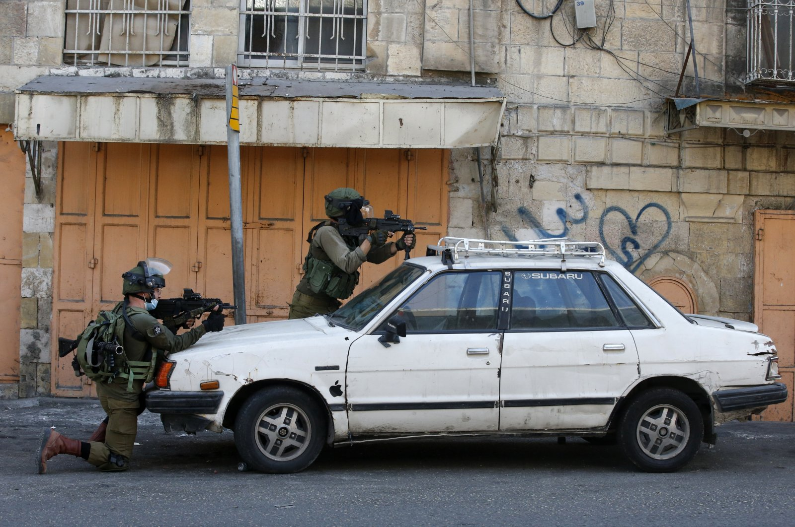 Israeli security forces aim their weapons amid clashes with Palestinian protesters in the Israeli-occupied West Bank town of Hebron, Sept. 25, 2020. (AFP Photo)