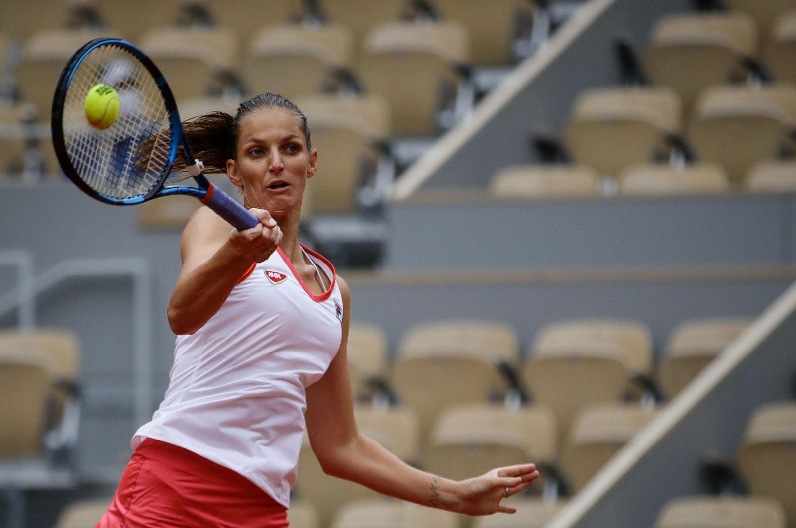 Karolina Pliskova returns the ball to Mayar Sherif during their French Open first round match, in Paris, France, Sept. 29, 2020. (AFP Photo)