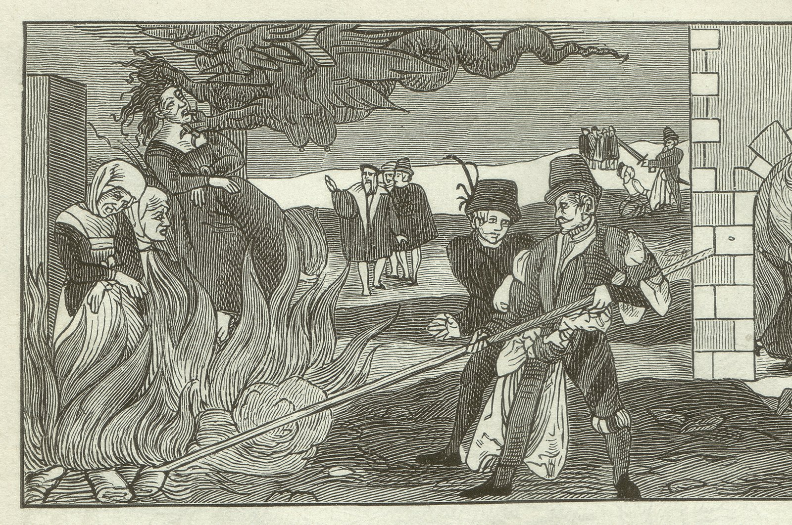 A woodcut engraving shows a witch-burning scene in the County of Regenstein of the Holy Roman Empire in 1555. (iStock Photo)