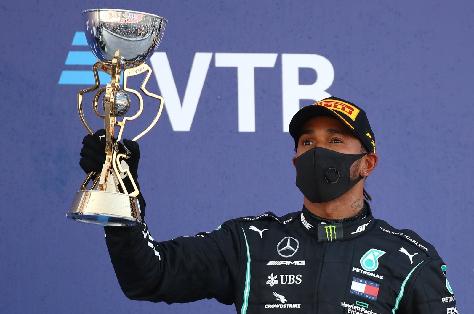 Mercedes driver Lewis Hamilton holds his trophy on the podium after finishing third in the Formula One Russian Grand Prix, in Sochi, Russia, Sept. 27, 2020. (AFP Photo)