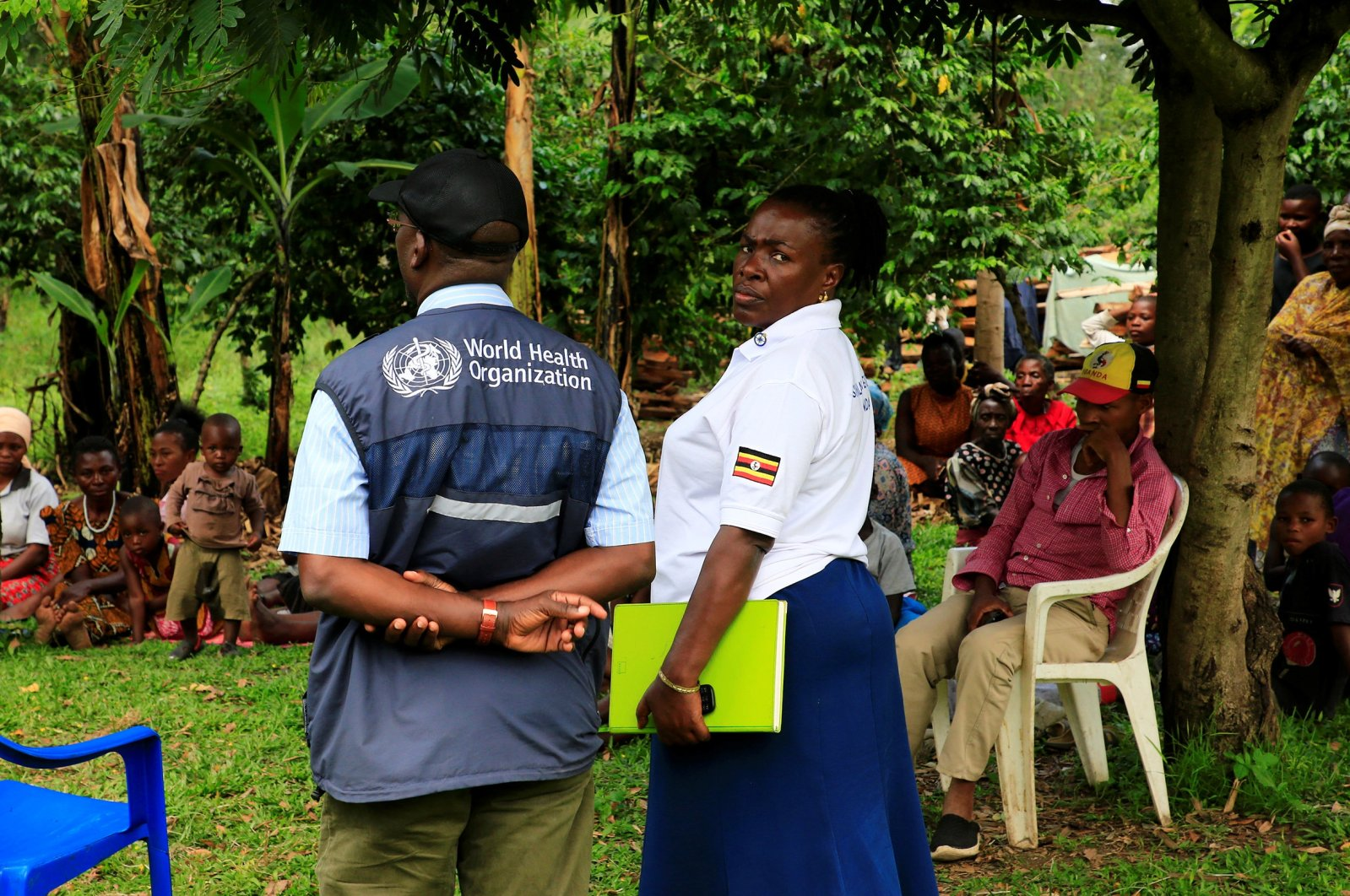 World Health Organization (WHO) officials and Ugandan health workers inform the community of Kirembo village, near the border with the Democratic Republic of Congo, about Ebola vaccine, in Kasese district, Uganda June 15, 2019. (Reuters Photo)