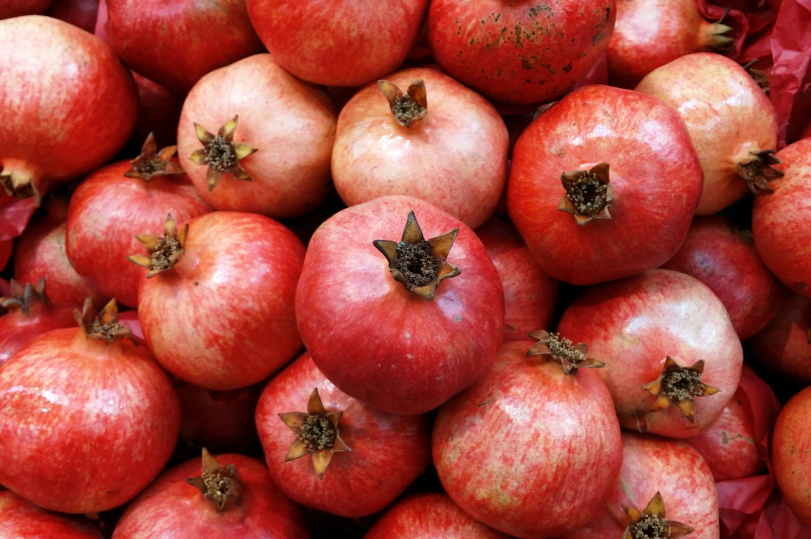 Did you know that while strawberries and raspberries are not actually classified as berries, pomegranates are botanically? (iStock Photo)