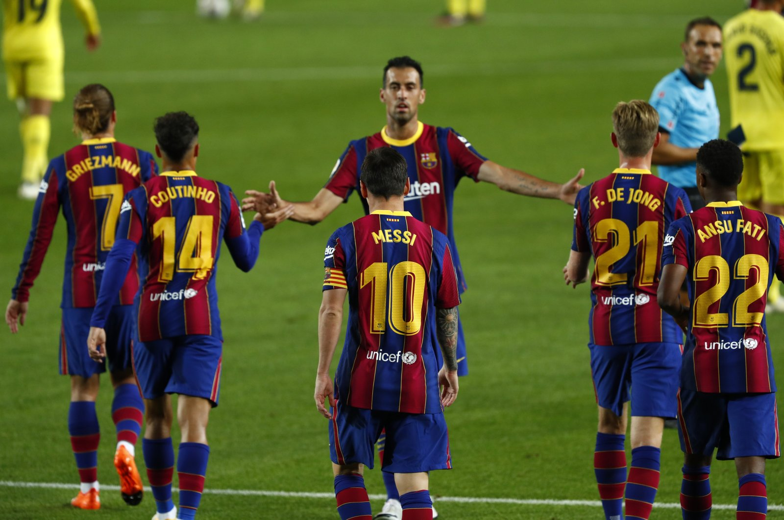 Barcelona's Lionel Messi celebrates with teammates after scoring a goal during the La Liga match against Villareal, in Barcelona, Spain, Sept. 27, 2020. (AP Photo)