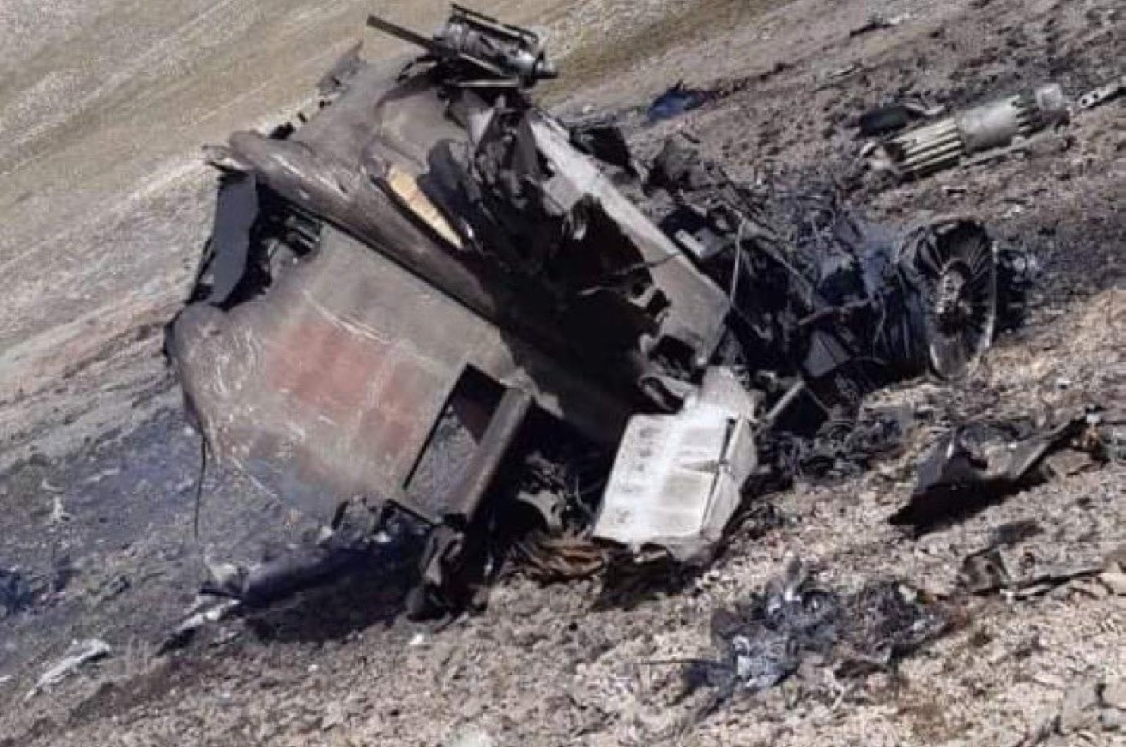 The remains of an Armenian Sukhoi Su-25 warplane that crashed into the mountains during fighting with Azerbaijan over the occupied Nagorny-Karabakh region, Azerbaijan, Sept. 30, 2020. (AFP)