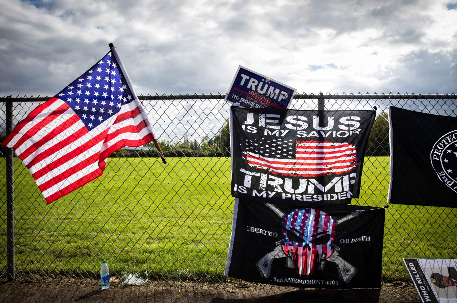 Flags are draped along a fence at a Proud Boys rally at Delta Park, Portland, Oregon, U.S. Sept. 26, 2020. (AFP Photo)
