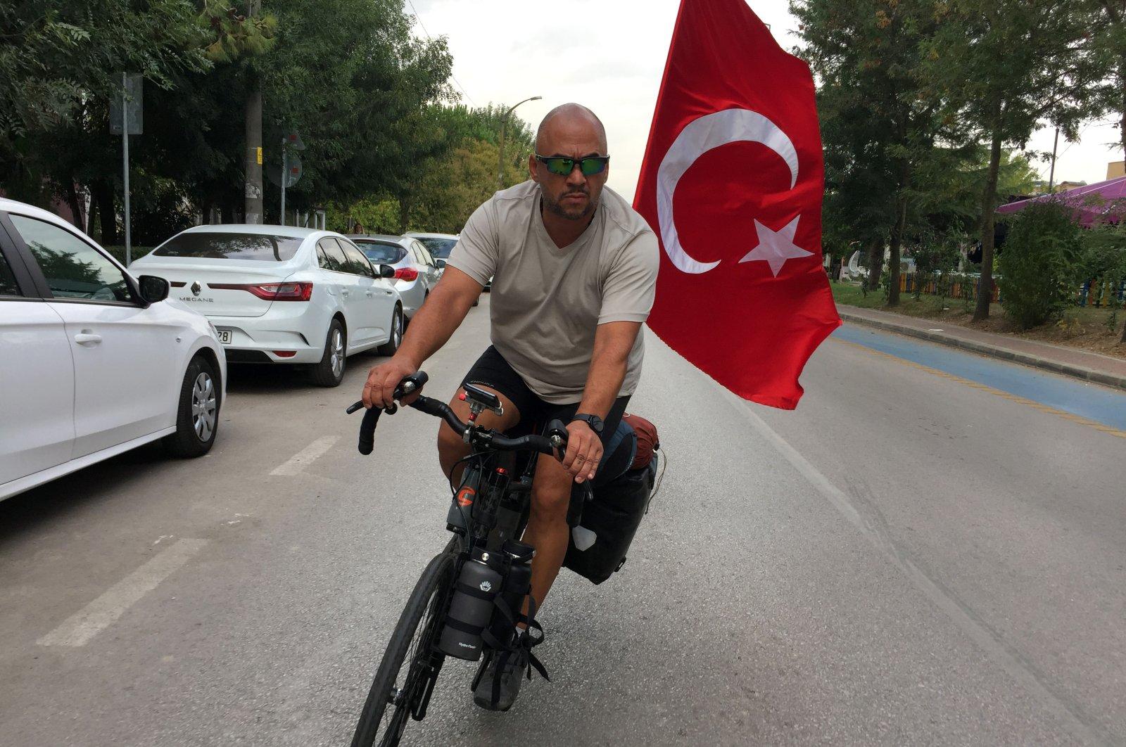 Recai Pak rides his bicycle, in Kocaeli, northwestern Turkey, Sept. 29, 2020. (AA Photo)