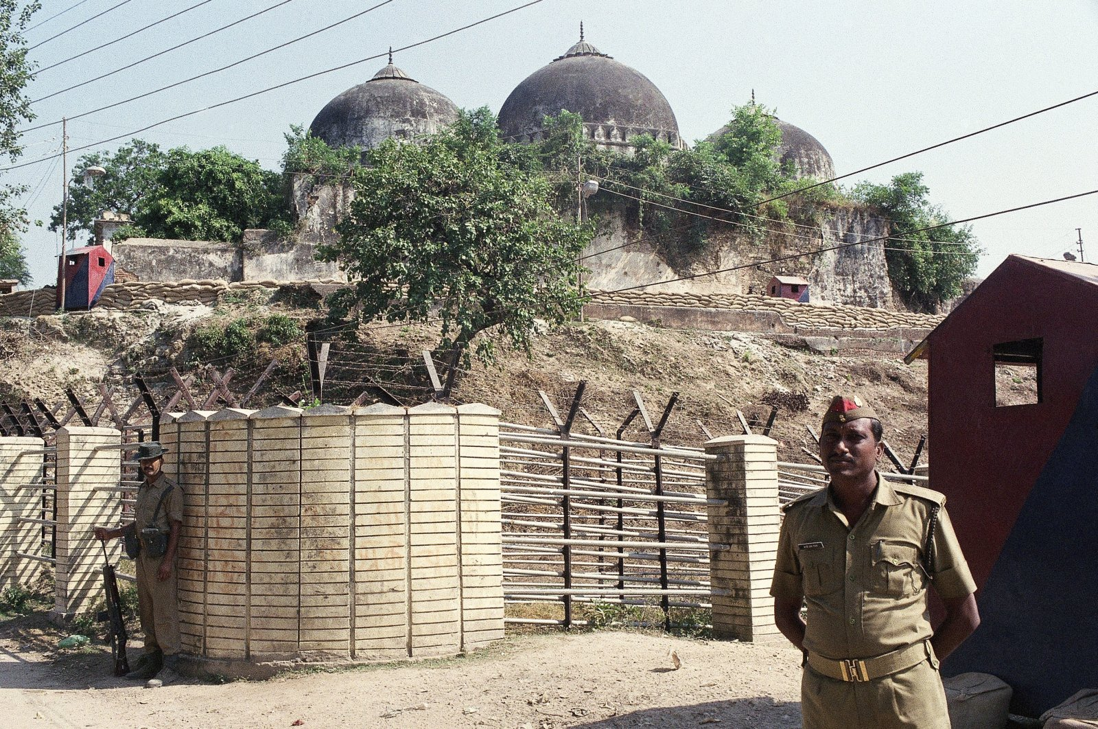 Security officers guard the Babri Mosque in Ayodhya, closing off the disputed site, Oct. 29, 1990. (AP Photo)