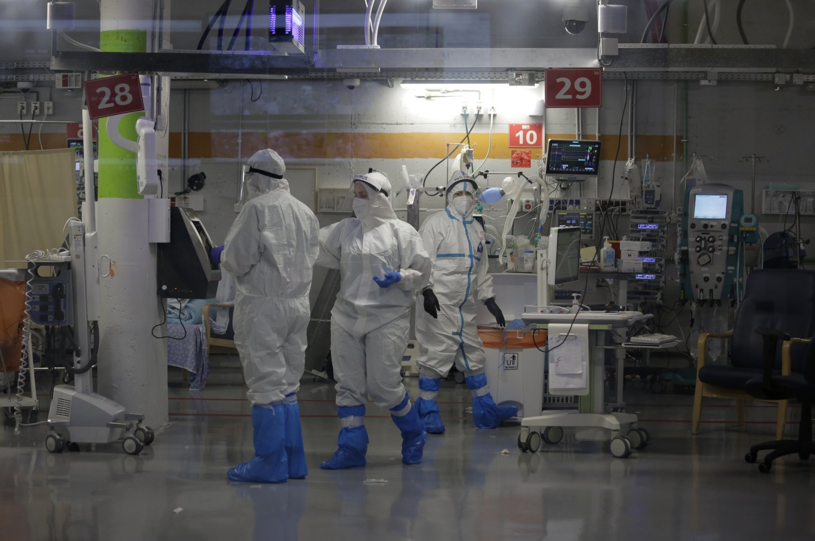 Amid a spike in COVID-19 cases, medical professionals in full protective equipment work in the critical care coronavirus unit that was built in an underground parking garage at Sheba Medical center in Rahmat Gan, Israel, Sept. 30, 2020. (AP Photo)