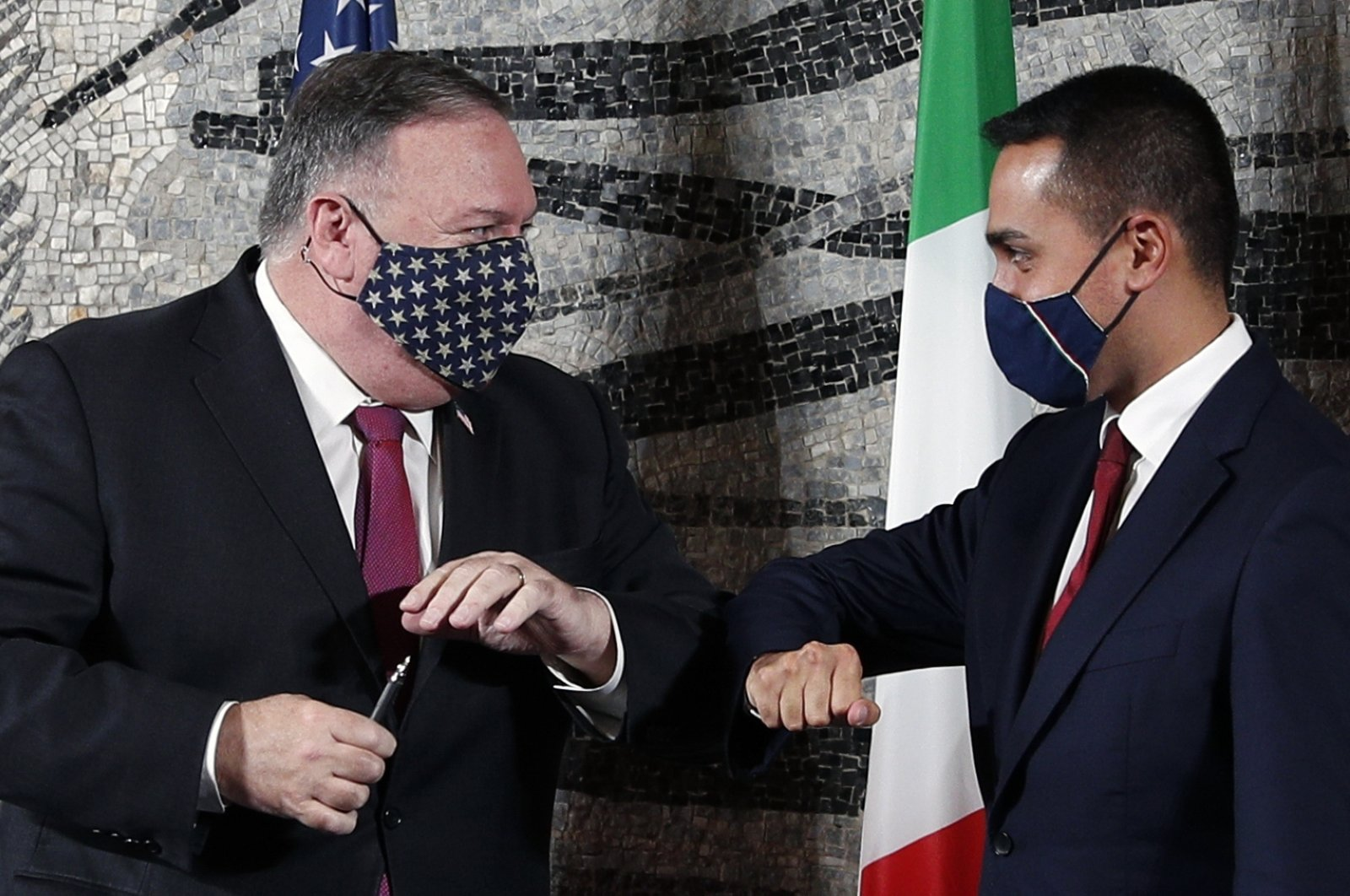 U.S. Secretary of State Mike Pompeo (L), bumps elbows with Italian Foreign Minister Luigi Di Maio in Rome, Sept. 30, 2020. (AP Photo)