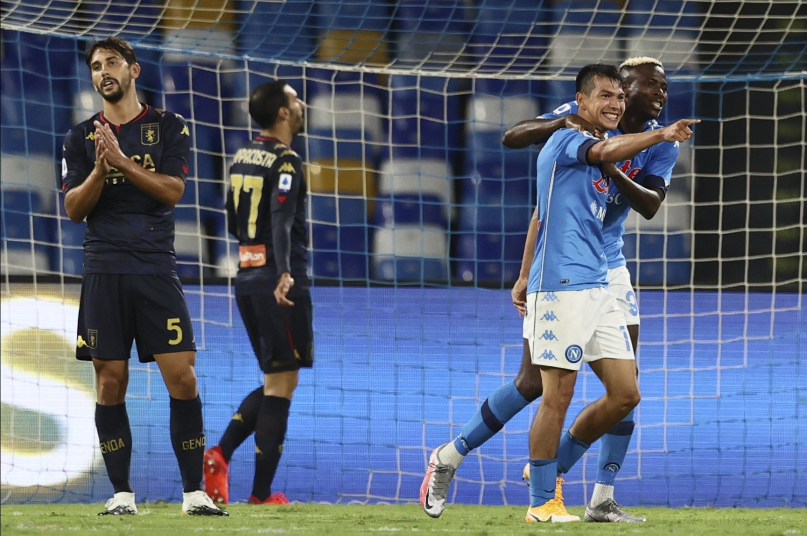 Napoli's Hirving Lozano, second from right, celebrates with Victor Osimhen after scoring his side's 4th goal during the Serie A football match between Napoli and Genoa at the San Paolo Stadium in Naples, Italy, Sept. 27, 2020. (LaPresse via AP)