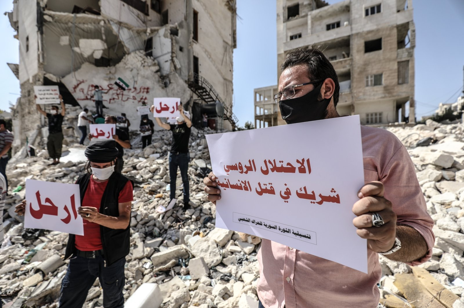Dozens of Syrians demonstrate in northwestern Syria's Idlib to mark five years of Russian intervention supporting Bashar Assad's regime in the civil war, Sept. 30, 2020. (AA Photo)