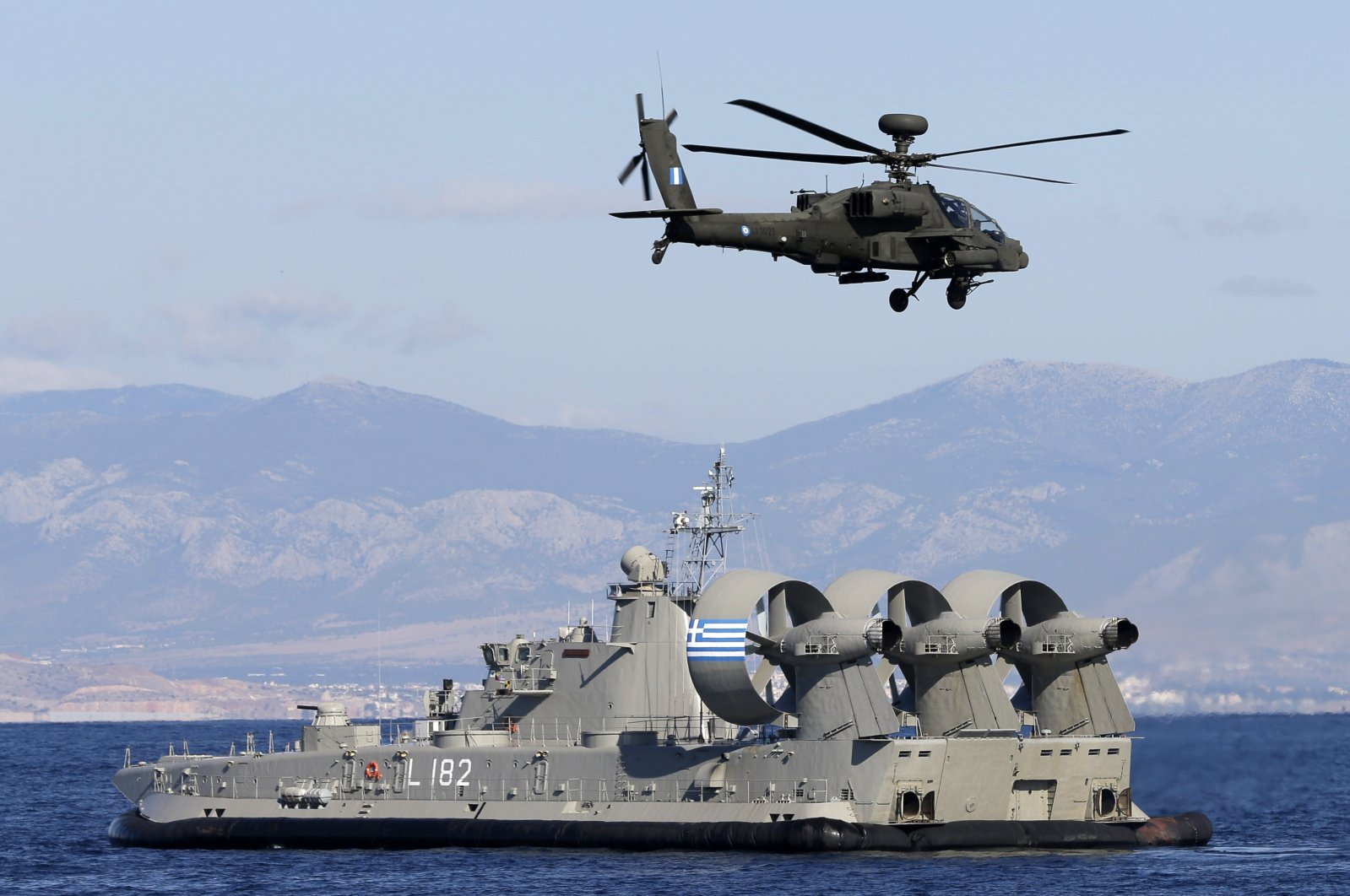 A military helicopter and naval hovercraft during a Greek joint military exercise Pyrpolitis on the Saronic Gulf, south of Athens on Oct. 30, 2014. (AP File Photo)