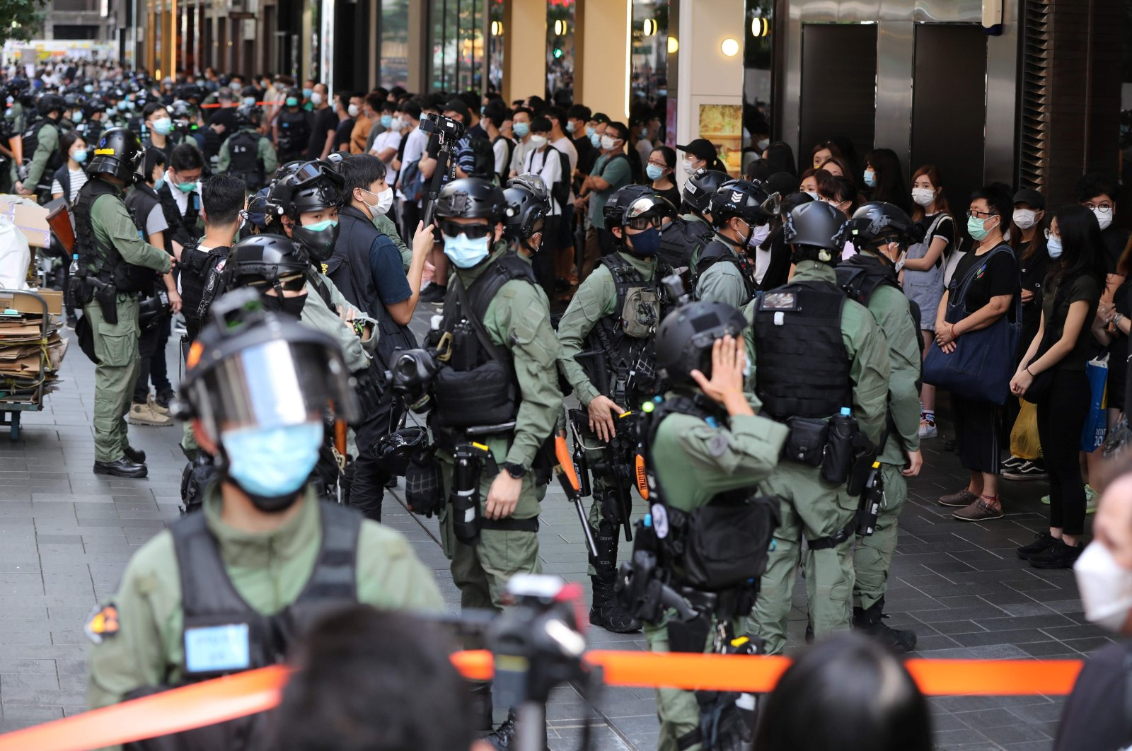 Police officers prepare to search people inside a cordon area during China's National Day, Hong Kong, Oct. 1, 2020. (AFP Photo)