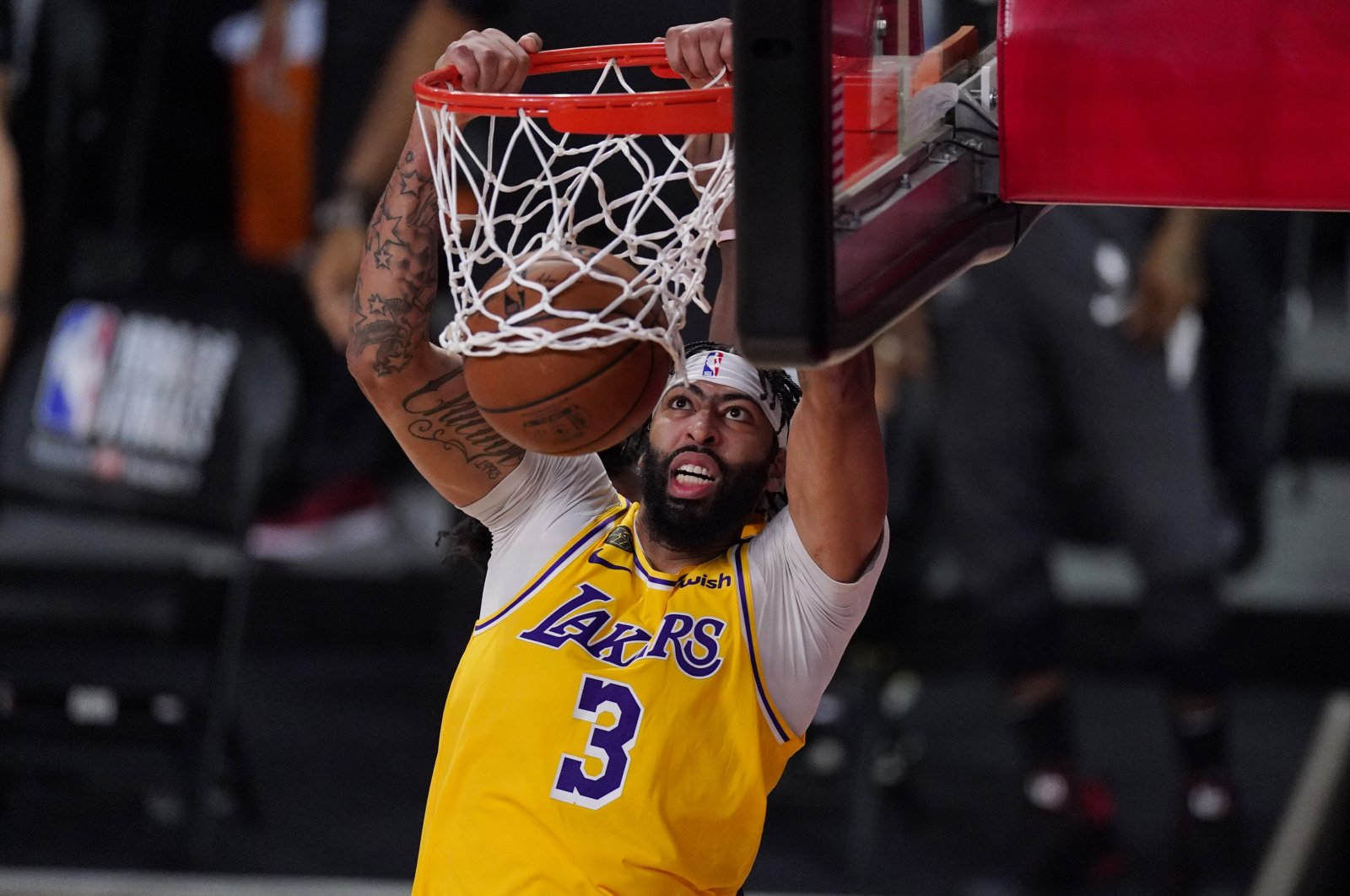 Los Angeles Lakers' Anthony Davis slams a dunk against the Miami Heat during Game 1 of NBA Finals, Lake Buena Vista, Florida, U.S., Sept. 30, 2020. (AP Photo)