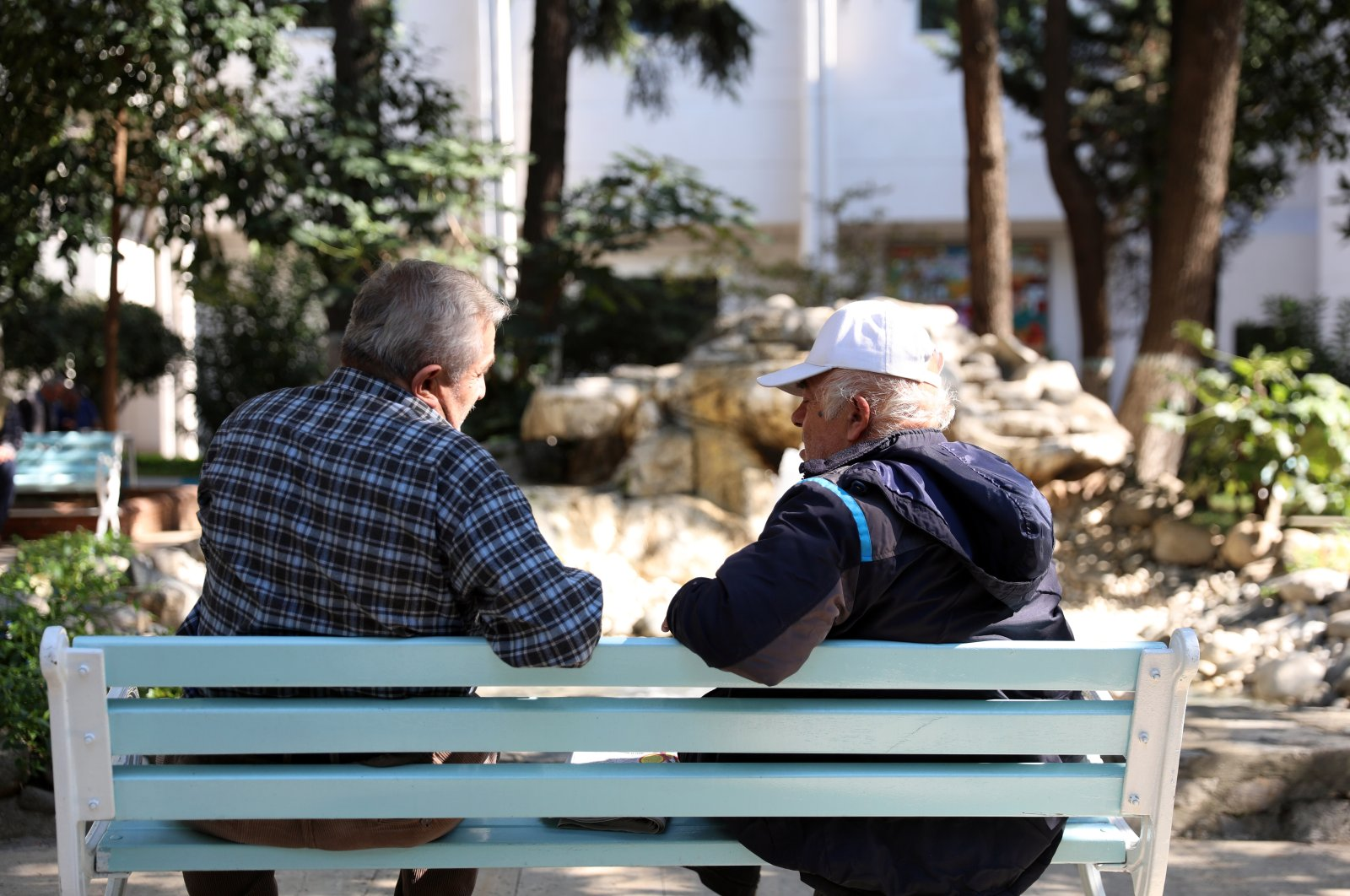 Two residents of Darülaceze nursing home chat in Istanbul, Turkey, Oct. 1, 2020. (AA Photo)