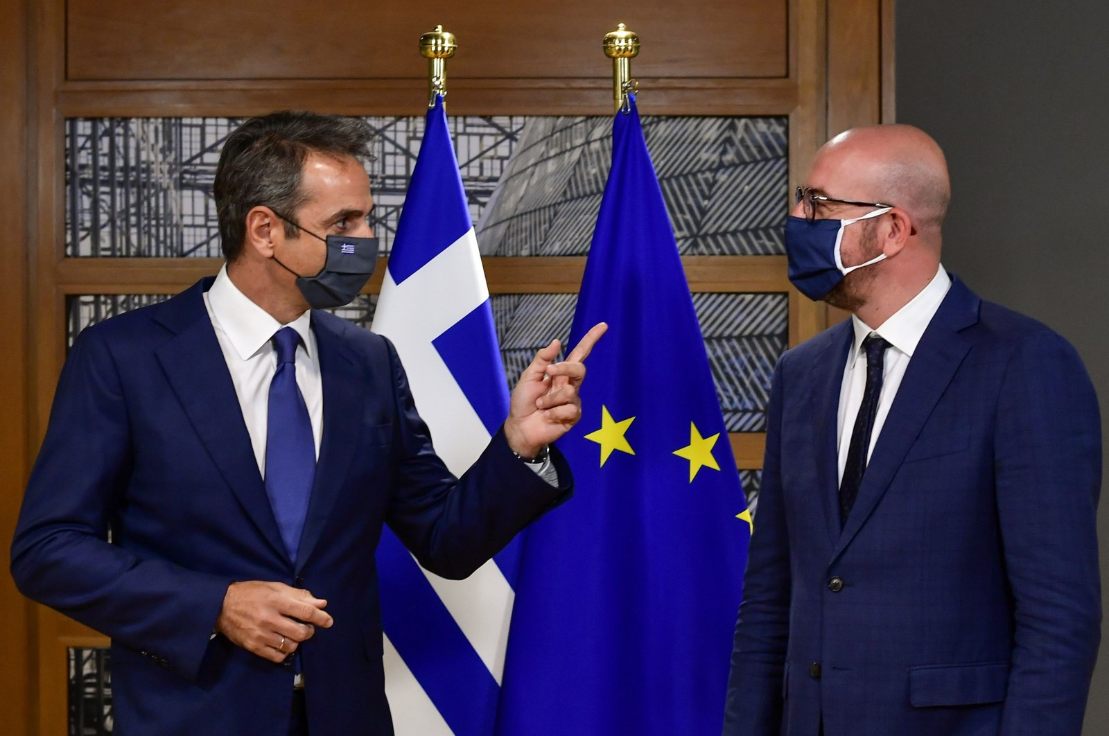 European Council President Charles Michel listens as Greek Prime Minister Kyriakos Mitsotakis speaks ahead of the second face-to-face European Union summit since the COVID-19 outbreak, in Brussels, Belgium, Oct. 1, 2020. (Reuters Photo)
