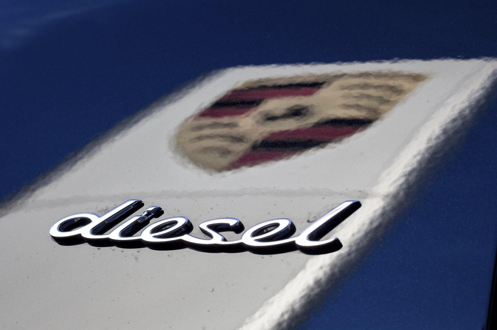 "The word ""diesel"" and the logo of German car manufacturer Porsche, Stuttgart, Germany, Nov. 4, 2015. (DPA via AP)"