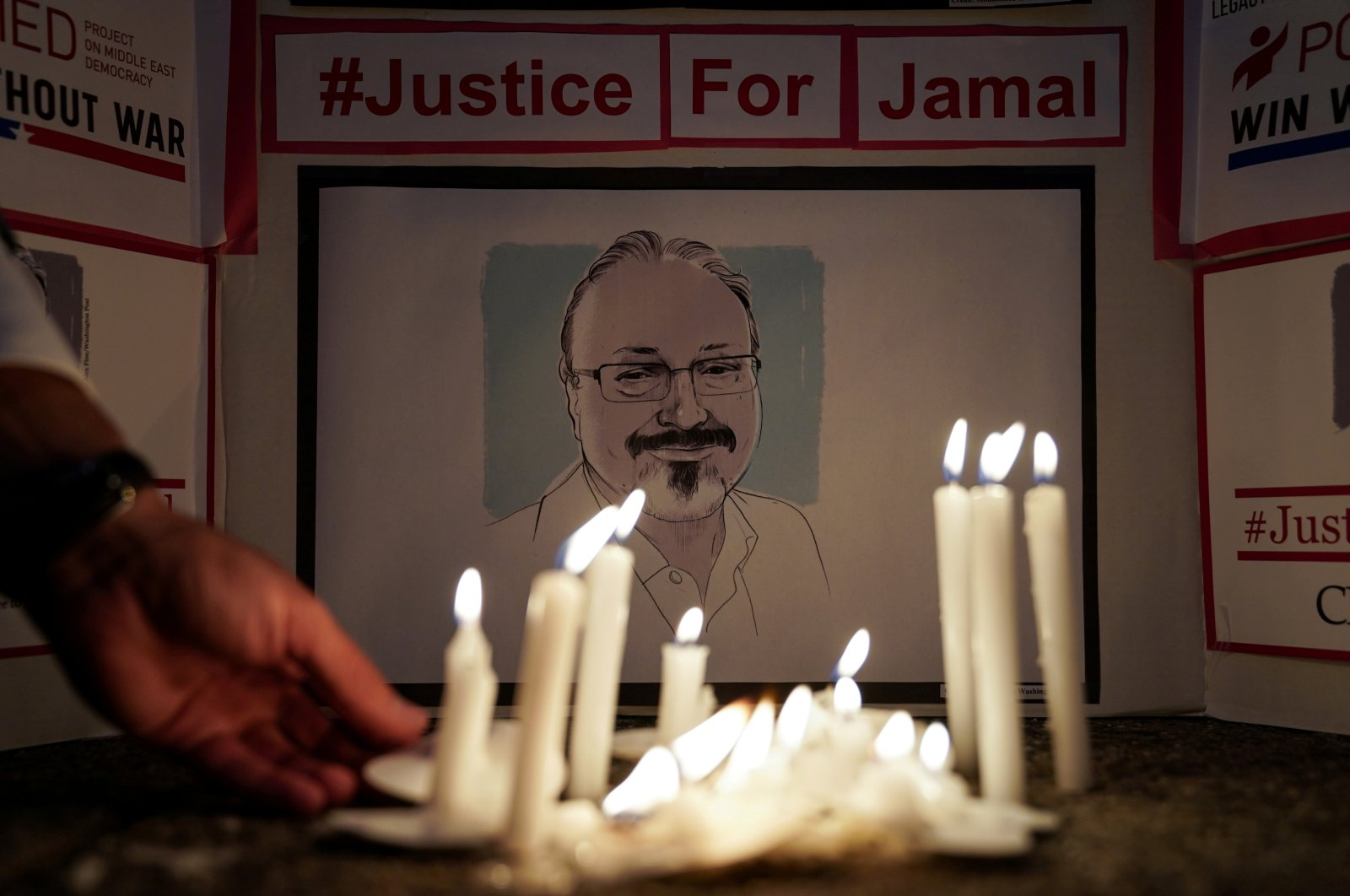 The Committee to Protect Journalists and other press freedom activists hold a candlelight vigil to mark the anniversary of the killing of journalist Jamal Khashoggi at the kingdom's consulate in Istanbul in front of the Saudi Embassy in Washington, D.C., Oct. 2, 2019. (REUTERS)