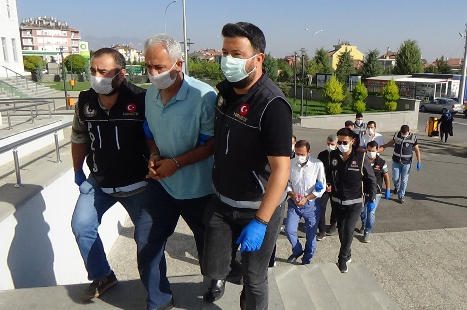 Police escort FETÖ suspects captured in an operation to the courthouse, in Karaman, central Turkey, Sept. 30, 2020. (IHA Photo)