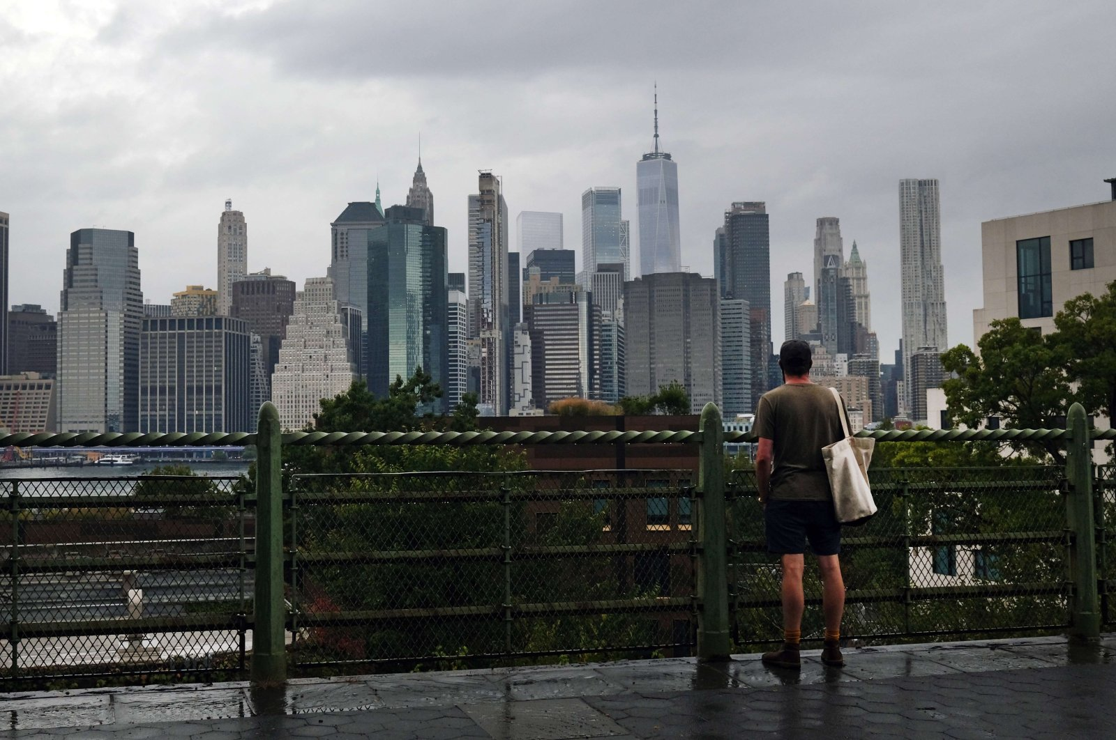 A man looks out at the Manhattan skyline in a Brooklyn neighborhood in New York City, Sept. 29, 2020. (AFP Photo)