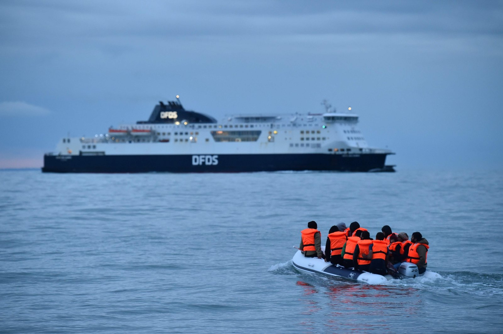 Migrants sail across the English Channel in a dinghy toward the south coast of England, Sept. 1, 2020. (AFP Photo)