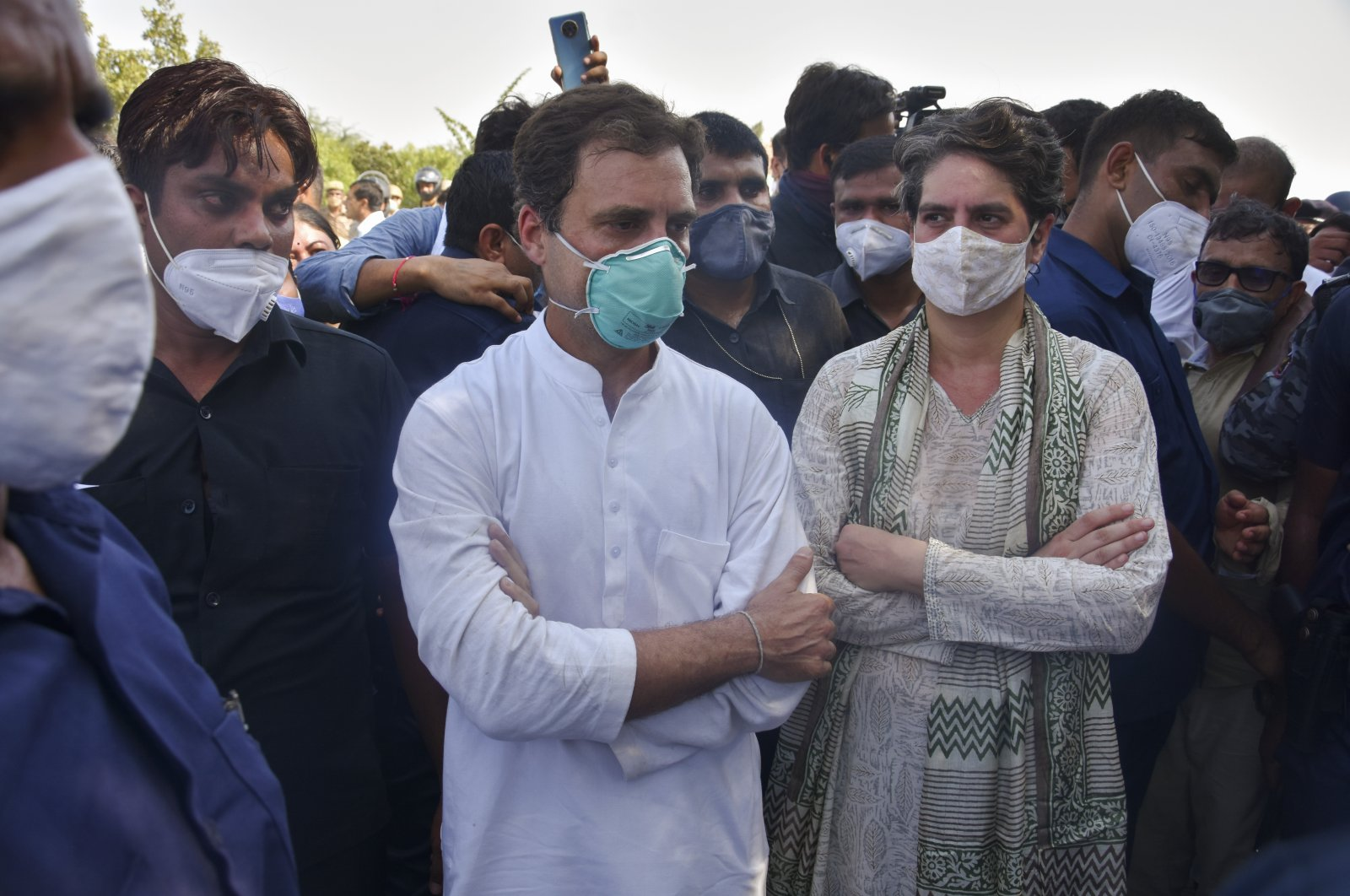 India's opposition Congress party leaders, Rahul Gandhi (C) and his sister Priyanka Gandhi (R) stand after they were stopped by police on a highway in Gautam Buddha Nagar, Uttar Pradesh state, India, Oct. 1, 2020. (AP Photo)