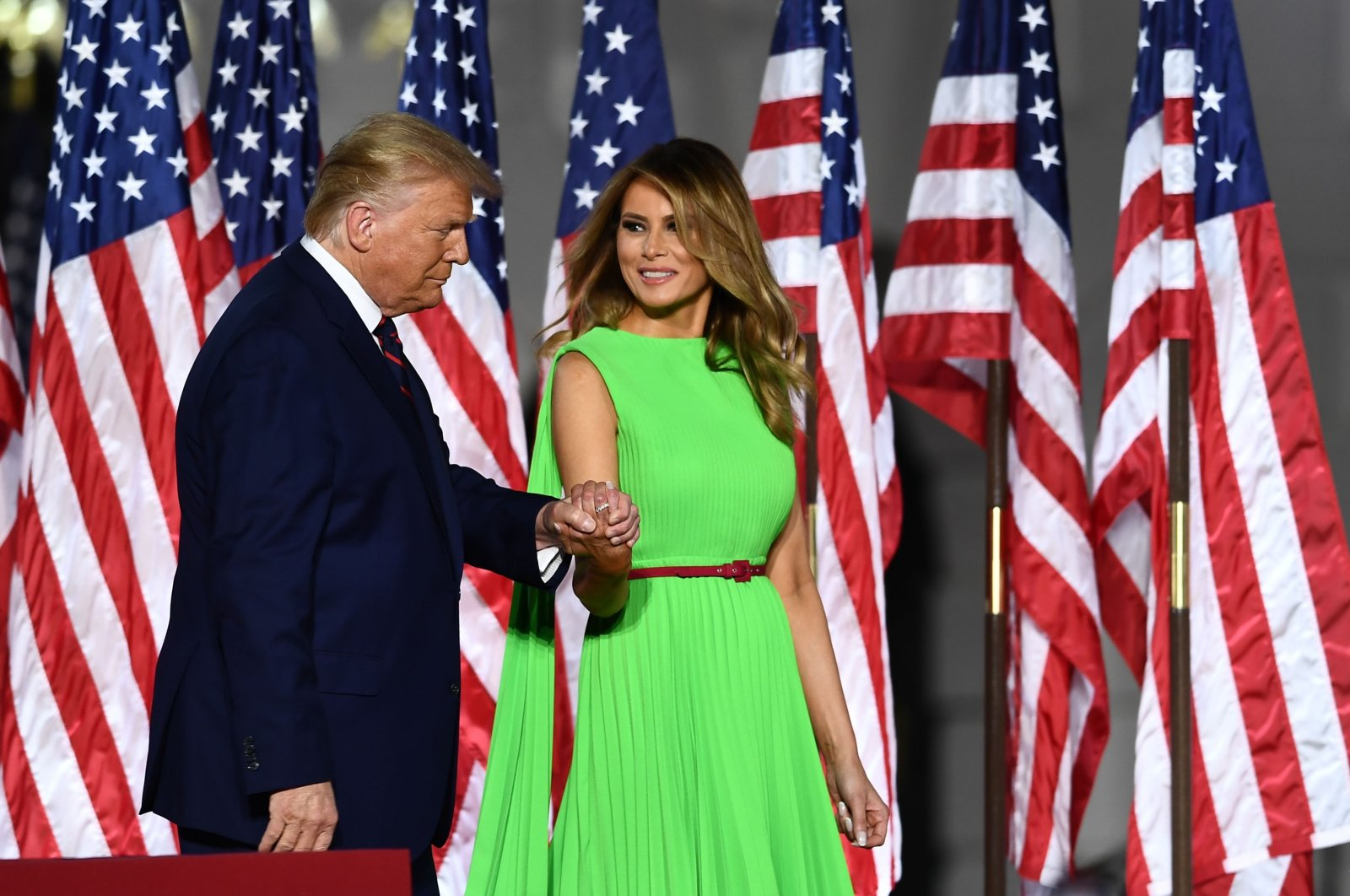 U.S. President Donald Trump (L) arrives with wife First Lady Melania Trump to deliver his acceptance speech for the Republican Party nomination for reelection during the final day of the Republican National Convention from the South Lawn of the White House in Washington, D.C, Aug.27, 2020. (AFP Photo)