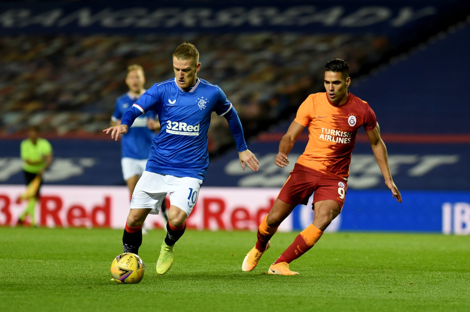 Rangers' Steven Davies (L) and Galatasaray's Radamel Falcao compete for the ball during the Europa League playoff match in Glasgow, Scotland, Oct. 1, 2020. (AA Photo)