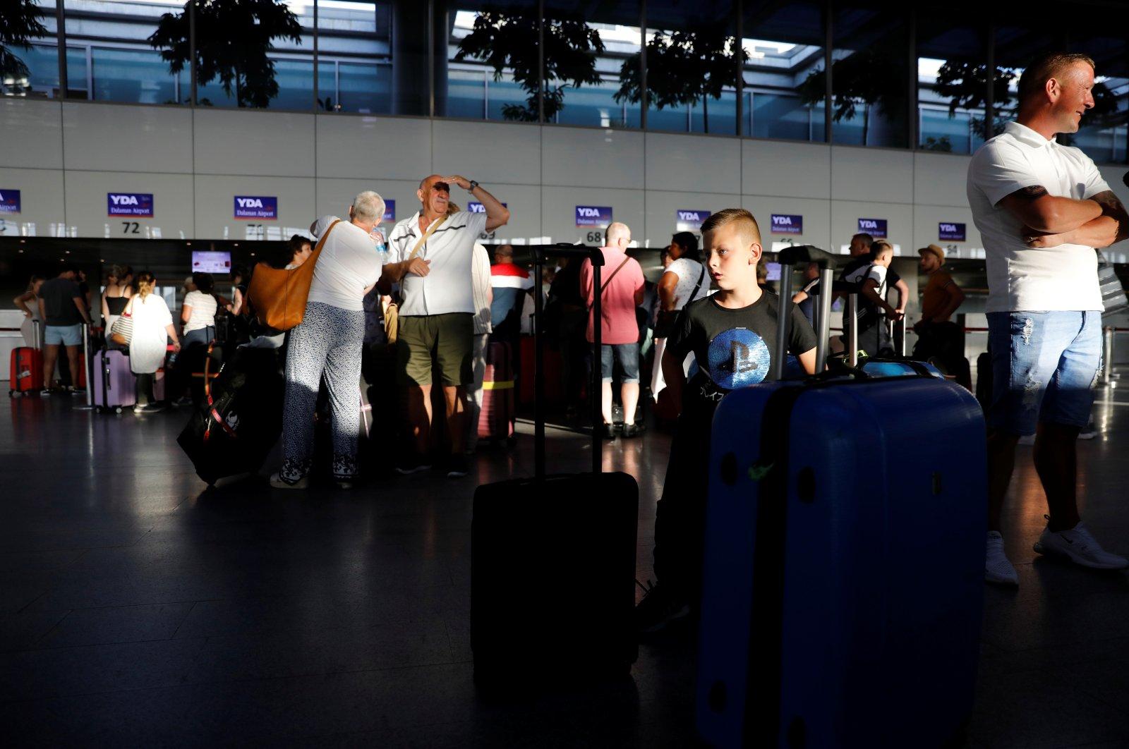 British tourists wait at Dalaman Airport in the southwestern province of Muğla, Turkey, Sept. 23, 2019. (Reuters Photo)