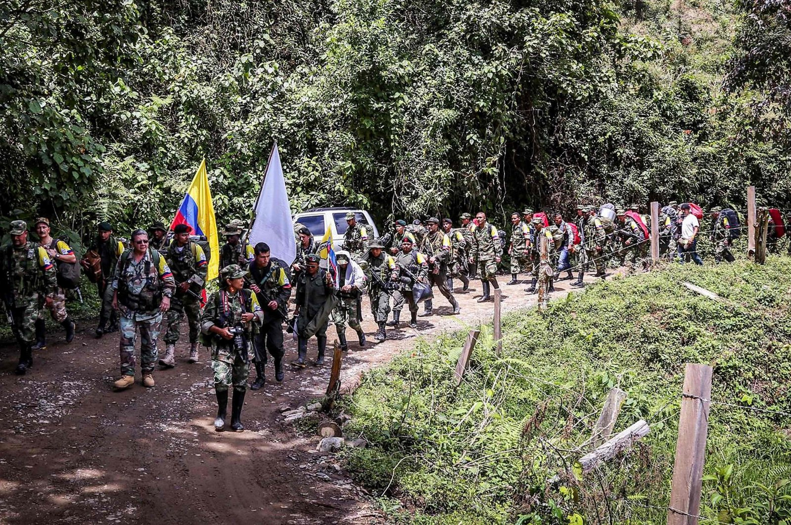 Handout picture released by the Revolutionary Armed Forces of Colombia (FARC) showing Commander Pablo Catatumbo leading rebels arriving to hand in their weapons in Buenos Aires, Cauca Department, Colombia on Jan. 1, 2017. (FARC Photo via AFP)