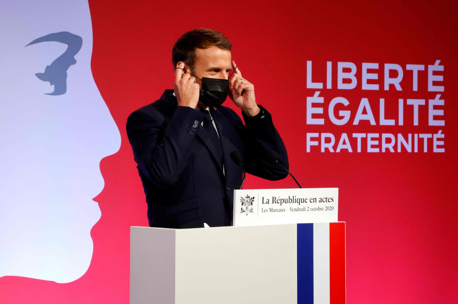 French President Emmanuel Macron wears a mask after delivering a speech in Les Mureaux, Paris, France, Oct. 2, 2020. (AFP Photo)