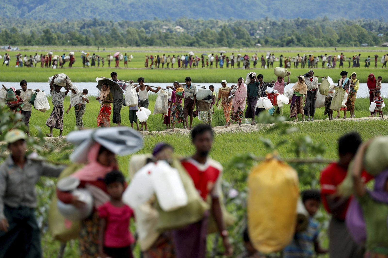 Rohingya refugees, who crossed the border from Myanmar two days before, walk after they received permission from the Bangladeshi army to continue on to the refugee camps, in Palang Khali, Bangladesh, Oct. 19, 2017. (Reuters Photo)