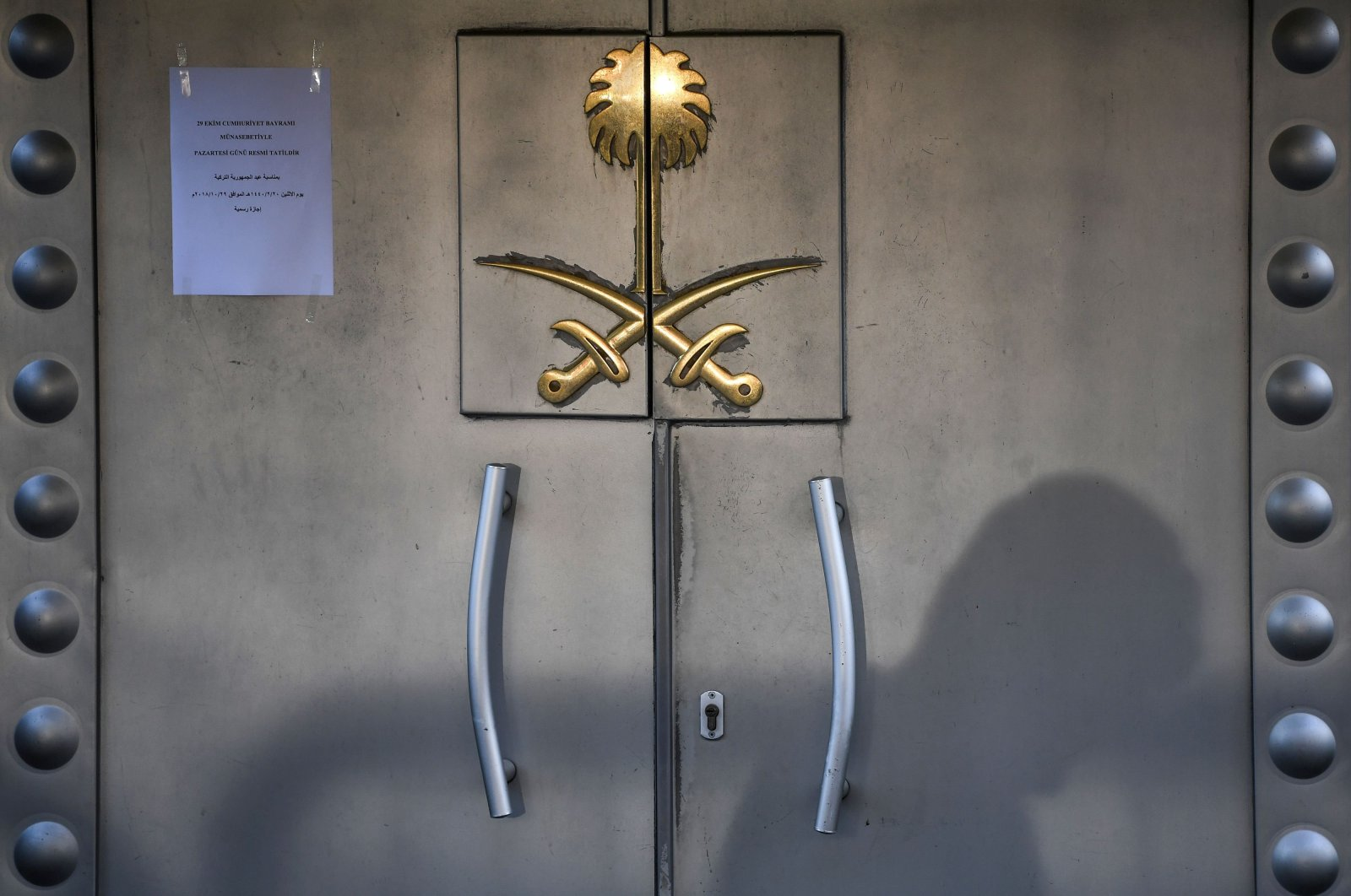 The shadow of a security member is seen on the door of the Saudi Arabian consulate in Istanbul, Turkey, Oct. 29, 2018. (AFP Photo)