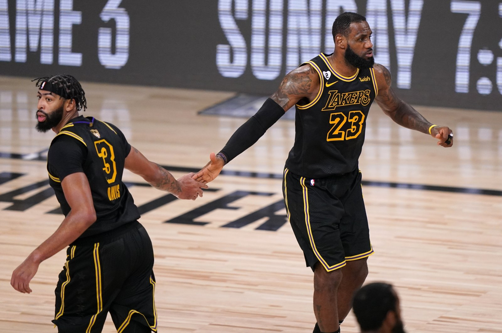 Los Angeles Lakers' Anthony Davis (3) and LeBron James (23) celebrate a basket against the Miami Heat during the second half of Game 2 of basketball's NBA Finals, Friday, Oct. 2, 2020, in Lake Buena Vista, Fla. (AP Photo)