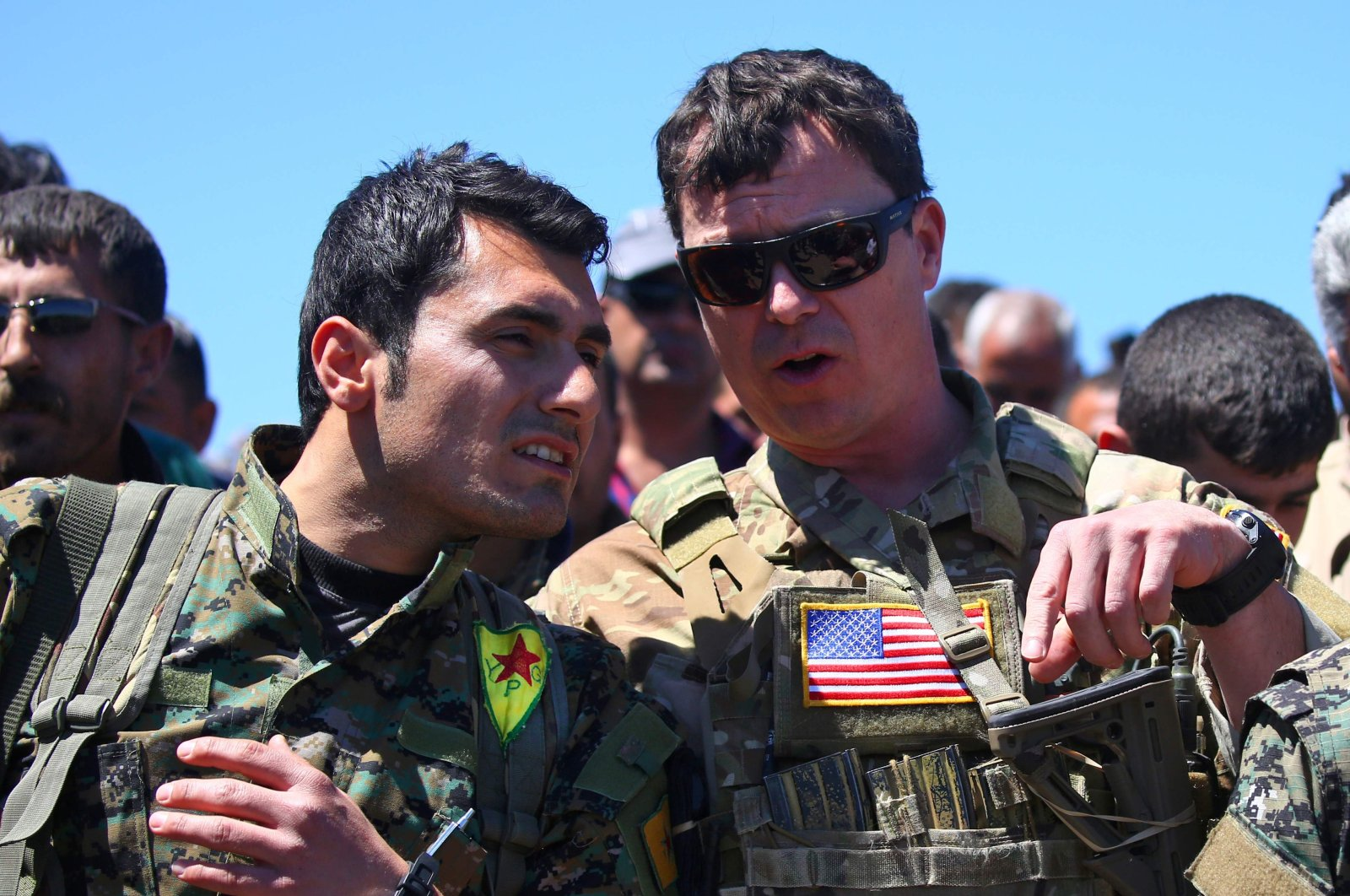 In this file photo, a U.S. military officer speaks with a YPG terrorist at the site of Turkish airstrikes near the town al-Malikiyah, northeastern Syria, April 25, 2017. (AFP Photo)