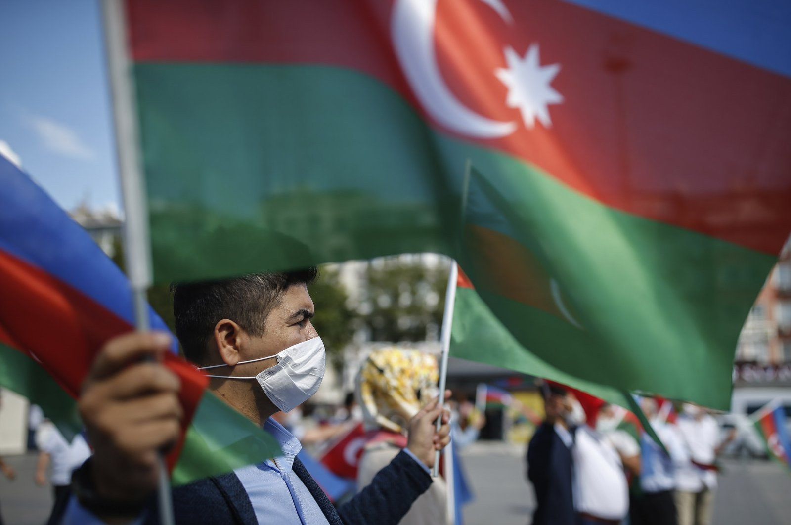 A demonstrator holds Azerbaijan's flag, during a protest supporting Azerbaijan, in Istanbul, Oct. 1, 2020. (AP Photo)