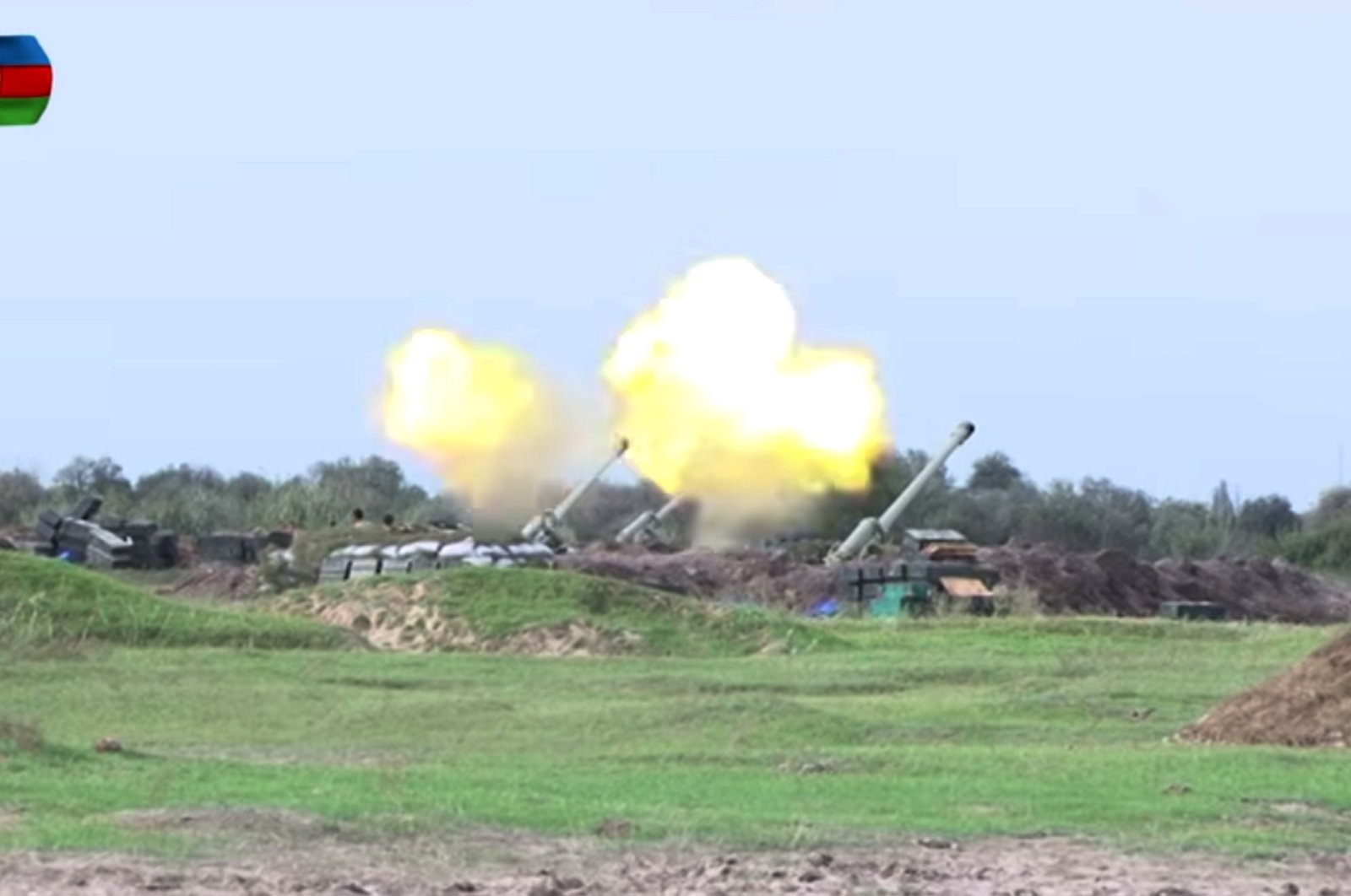 A still image taken from a video released on Sept. 29, 2020, by Azerbaijan's Ministry of Defense shows Azerbaijani artillery being fired at enemy positions deployed in the illegally occupied Nagorno-Karabakh region. (EPA / Azerbaijan Defense Ministry / Handout)