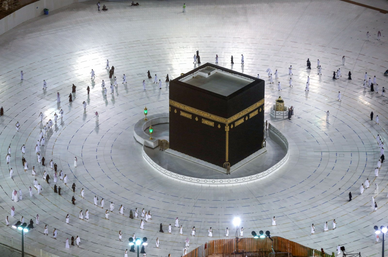 Saudis and foreign residents circumambulate (tawaf) the Kaaba in the Grand Mosque complex as authorities partially resume the year-round umrah for a limited number of pilgrims amid extensive health precautions after a seven-month coronavirus hiatus, Mecca, Saudi Arabia, Oct. 4, 2020. (AFP Photo)