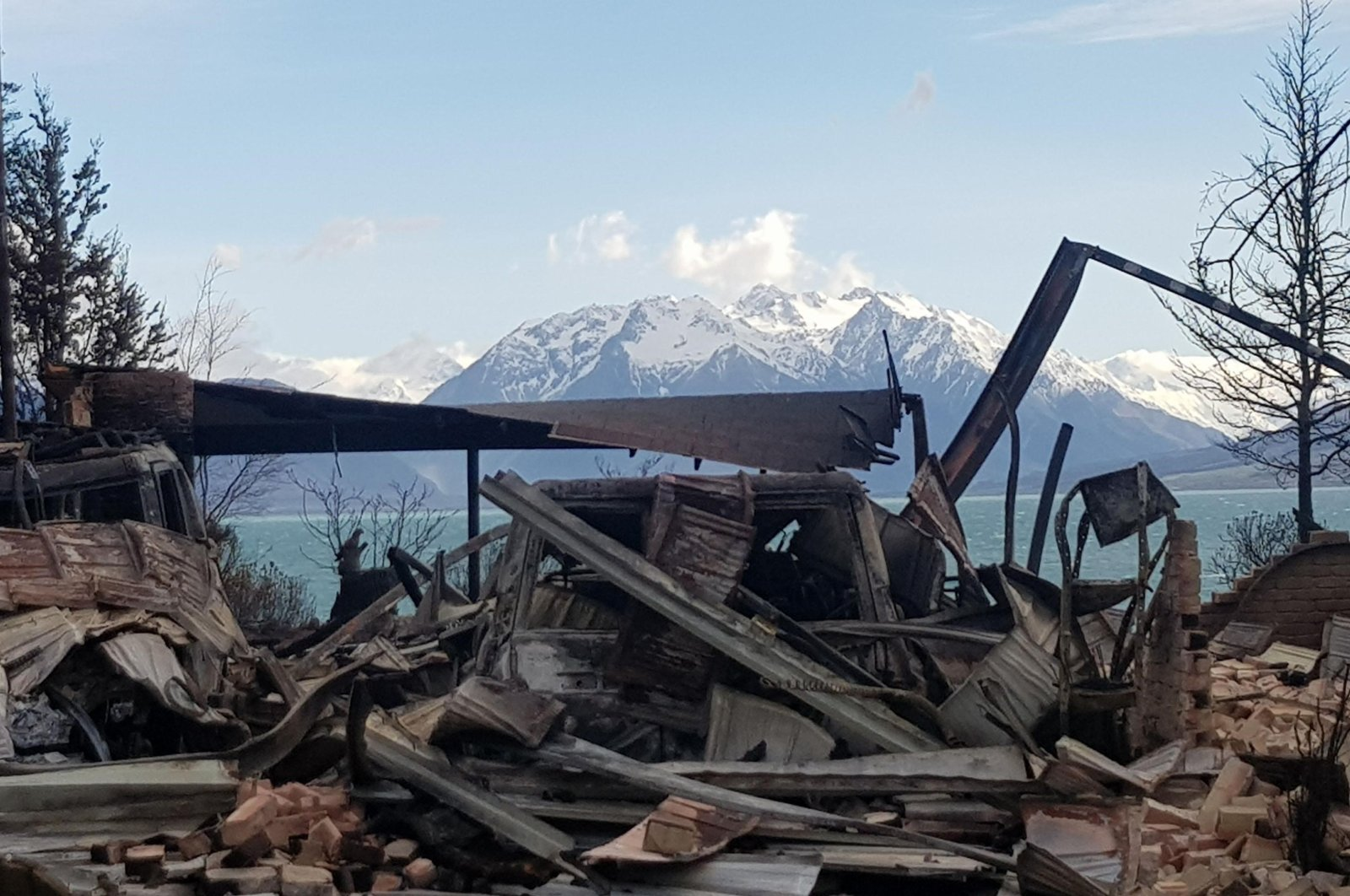 This handout photo taken and released on Oct. 5, 2020, shows damage caused by the South Island wildfires in Lake Ohau, New Zealand. (AFP Photo/Courtesy of Gary Kircher)