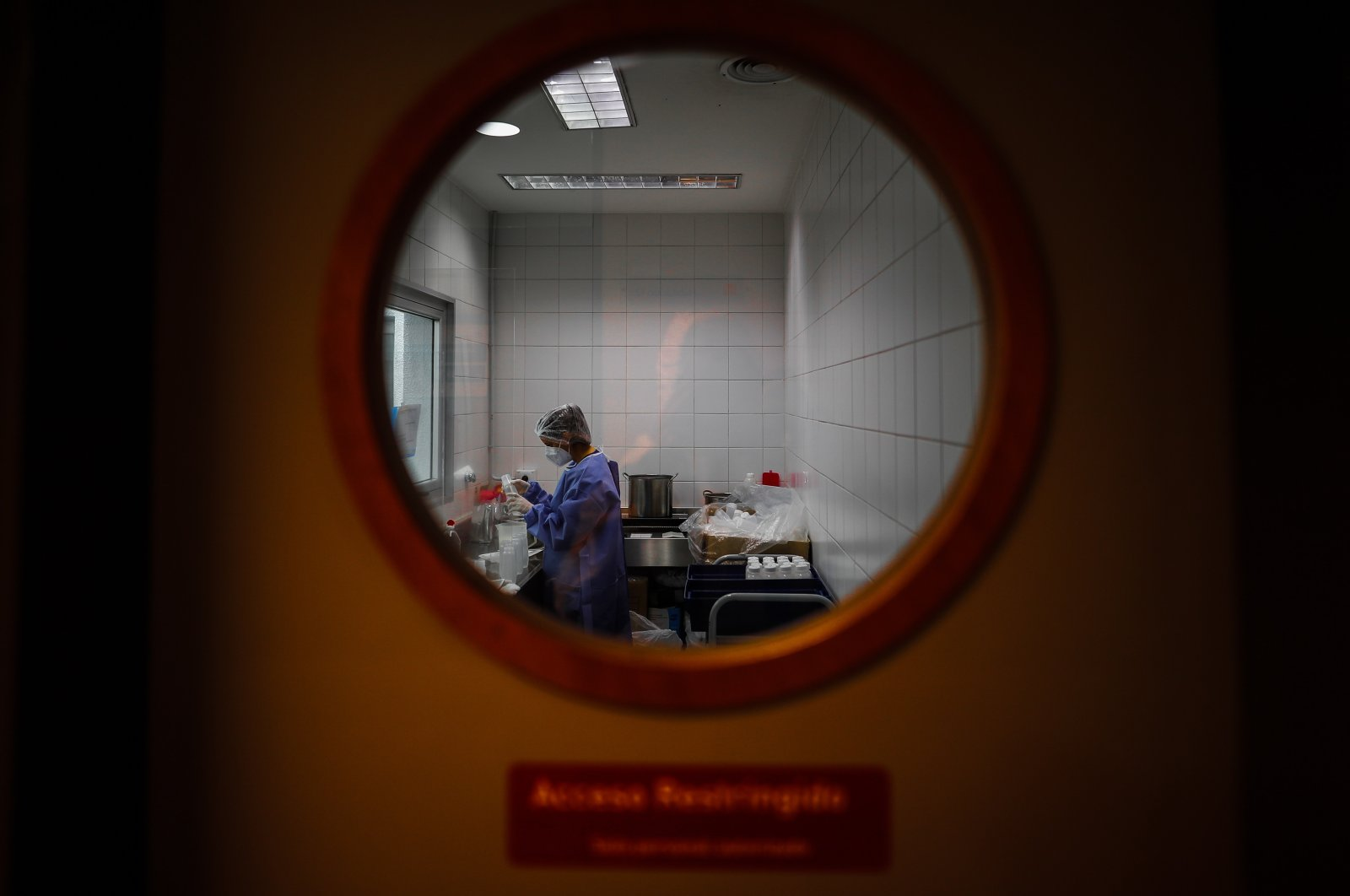A doctor prepares before checking on COVID-19 patients, in a hospital in the Province of Buenos Aires, Argentina, Sept. 6, 2020. (EPA Photo)