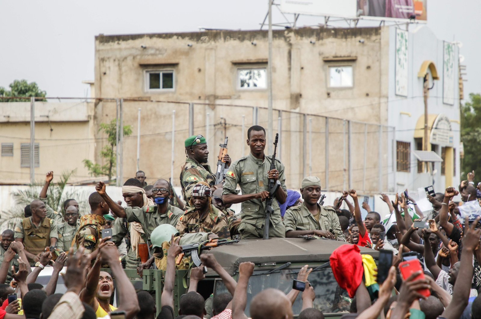 Armed members of the FAMA (Malian Armed Forces) are celebrated by the population as they parade at Independence Square in Bamako after rebel troops seized Malian President Ibrahim Boubacar Keita and Prime Minister Boubou Cisse in a dramatic escalation of a months-long crisis, Bamako, Mali, Aug.18, 2020. (AFP Photo)