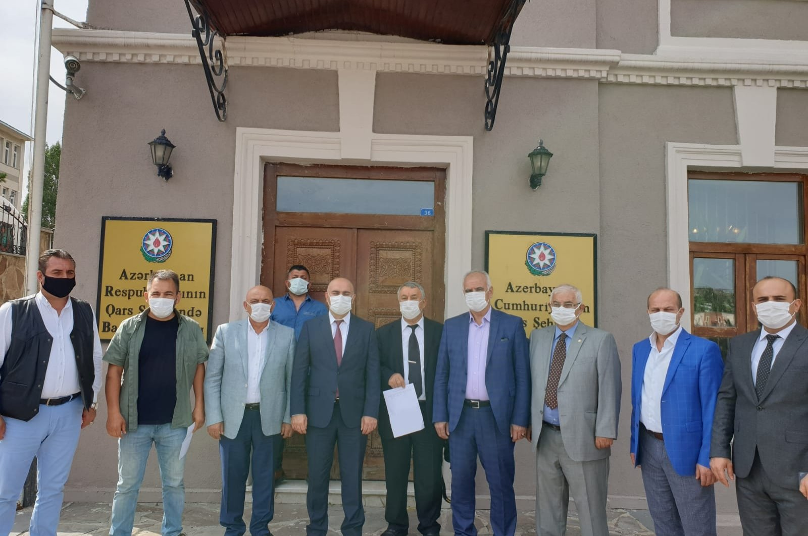 Representatives of several Turkish NGOs pose in front of the consulate-general of Azerbaijan in Kars after volunteering to fight alongside Azerbaijani forces, Kars, Oct. 4, 2020. (DHA)