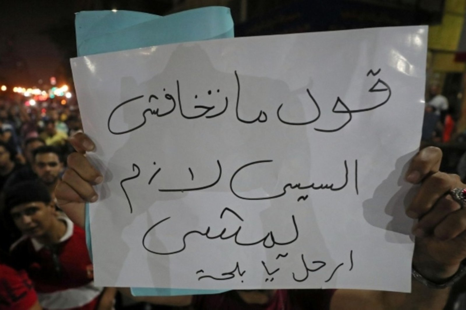 """A protester carries a sign that reads, """"Don't be afraid; say el-Sissi must leave Cairo,"""" Sept. 21, 2019. (REUTERS Photo)"""