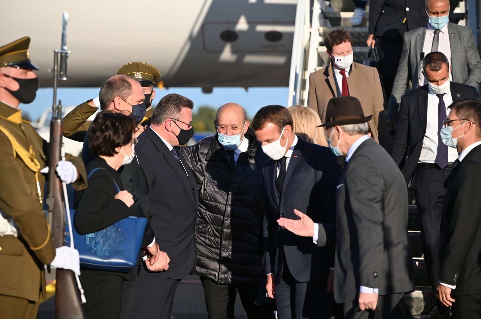 Lithuanian Foreign Minister Linas Linkevicius welcomes French President Emmanuel Macron and Foreign Affairs Minister Jean-Yves Le Drian upon their arrival in Vilnius, Lithuania, Sept. 28, 2020. (Lithuanian Foreign Affairs Ministry Photo via Reuters)